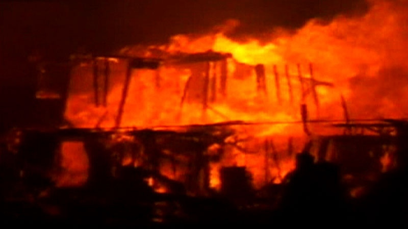 A massive blaze rips through a home in New York, Monday, Oct. 29, 2012.