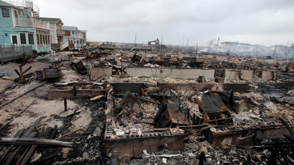 Homes destroyed by a fire at Breezy Point are shown, in the New York City borough of Queens Tuesday, Oct. 30, 2012, in New York.  (AP / Frank Franklin II)