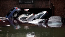 Sandy leaves cars floating in NYC