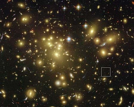 The square shows the general location of galaxy A1689-zD1, which was just forming 13 billion years ago, in relation to galaxy cluster Abell 1689. (Photo: NASA)