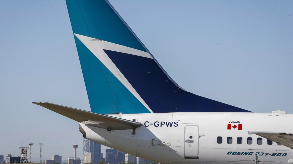 The tail of a WestJet plane is shown on Tuesday, May 3, 2016. (Jeff McIntosh / THE CANADIAN PRESS)