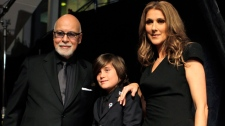 Celine Dion poses with her husband Rene Angelil and son Rene Charles Angelil as they arrive for the premiere of the film 'Celine: Through the Eyes of the World' in Miami Beach, Fla. Tuesday, Feb. 16, 2010. (AP / Lynne Sladky)