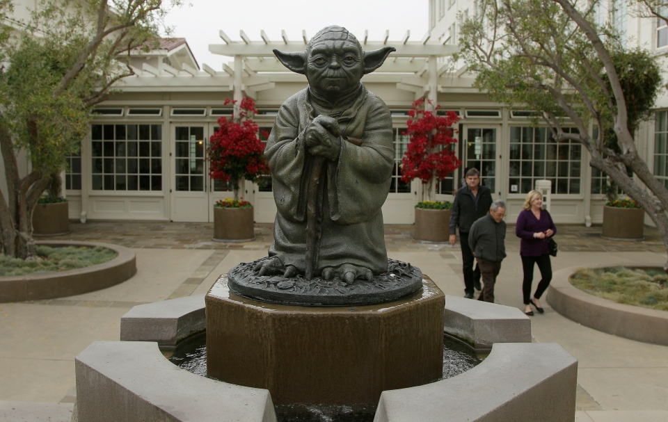 People walk past a fountain showing the Yoda character from the Star Wars movies outside of Lucasfilms headquarters in San Francisco, Tuesday, Oct. 30, 2012. (AP / Jeff Chiu)