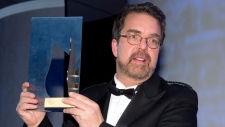 Giller Prize winner Will Ferguson shows trophy