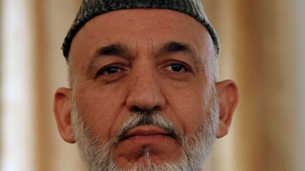 Afghan President Hamid Karzai listens during a press conference in Kabul, Afghanistan, Monday, Oct. 25, 2010. (AP / Allauddin Khan)