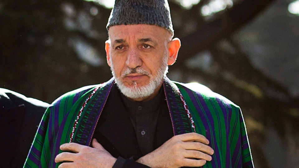 Afghan President Hamid Karzai arrives to review the guard of honor, during the first day of Eid Al Adha celebrations at the palace in Kabul, Afghanistan, Friday, Oct 26, 2012. (AP / Anja Niedringhaus)