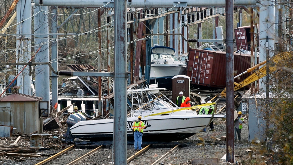 Workers try to clear boats and debris from the New Jersey Transit's Morgan draw bridge in South Amboy, N.J., Wednesday, Oct. 31, 2012. (AP / Mel Evans)