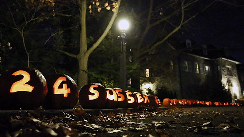 Carved pumpkins line the driveway to Prime Minister Stephen Harper's official residence at 24 Sussex Drive in Ottawa on Tuesday, October 30, 2012. THE CANADIAN PRESS/Fred Chartrand