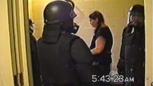 Surveillance video shows guards in full riot gear surrounding Ashley Smith.