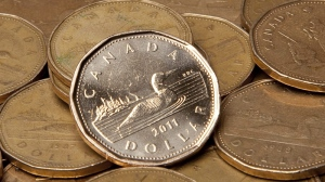 Canadian dollars are pictured in Vancouver, B.C. Thursday, Sept. 22, 2011. THE CANADIAN PRESS/Jonathan Hayward