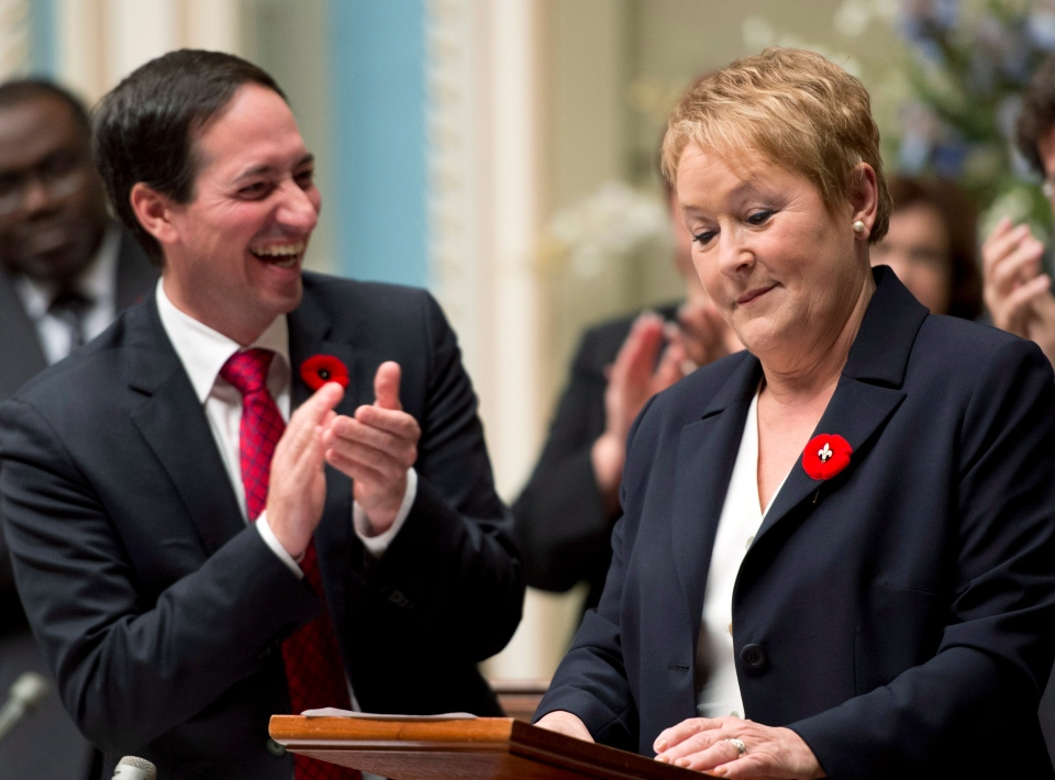Quebec Premier Pauline Marois is applauded by government leader Stephane Bedard during the inaugural speech at the legislature in Quebec City on Wednesday, Oct. 31, 2012. (Jacques Boissinot / THE CANADIAN PRESS)