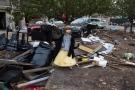 Lisa Kravchenko, of Staten Island, stands amongst flood debris in her princess Halloween costume, Wednesday, Oct. 31, 2012, in the Staten Island borough of New York. (AP / John Minchillo)