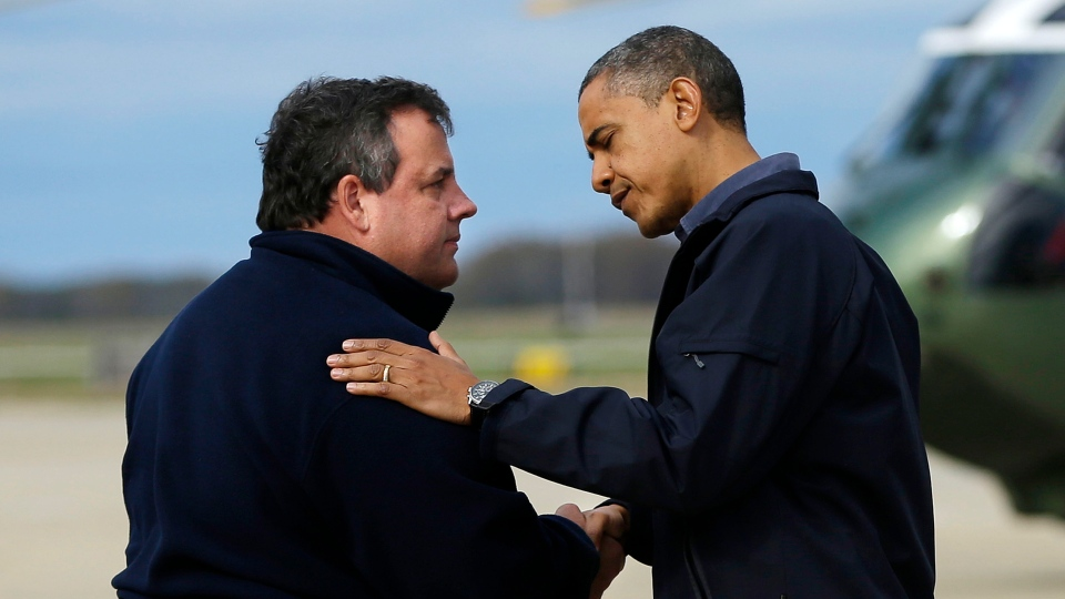 U.S. President Barack Obama is greeted by New Jersey Gov. Chris Christie upon his arrival at Atlantic City International Airport in Atlantic City, N.J. on Wednesday, Oct. 31, 2012. (AP /Pablo Martinez Monsivais)
