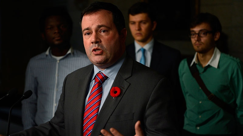 Jason Kenney, Minister of Citizenship, Immigration and Multiculturalism, speaks with media following the tabling of the 2013 Immigration Levels Plan on Parliament Hill in Ottawa Wednesday Oct. 31, 2012. (Adrian Wyld / THE CANADIAN PRESS)