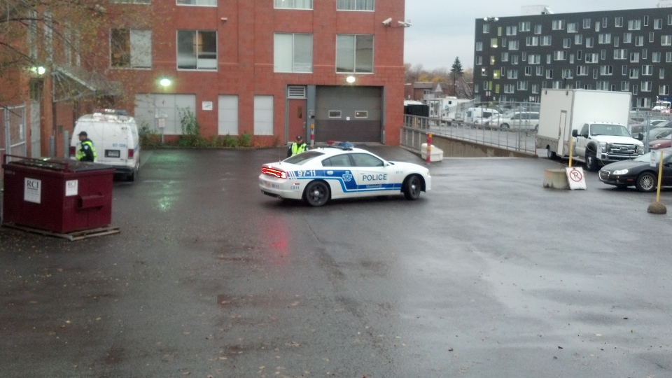 Police are seen at SPVM's Centre Operationnel Nord in Montreal after a raid on Thursday, Nov. 1, 2012.