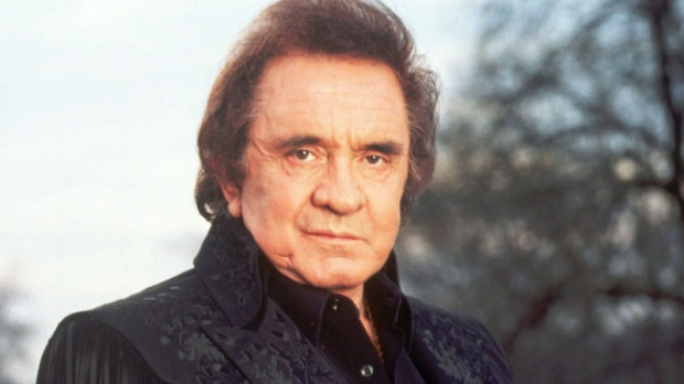 Singer Johnny Cash is shown in this 1995 publicity photo. The man in black will be bringing in some green when Johnny Cash's guitars, costumes, handwritten lyrics and personal belongings go on the auction block. (TBS / Mark Hill)