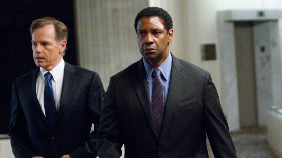 Bruce Greenwood portraying Charlie Anderson, left, and Denzel Washington portraying Whip Whitaker in a scene from Paramount Pictures' 'Flight.'