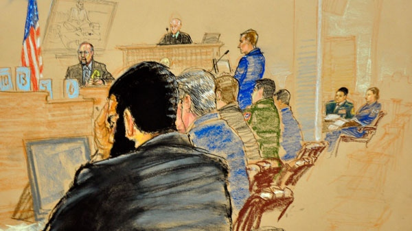 In this photo of a sketch by courtroom artist Janet Hamlin and reviewed by a U.S. Department of Defense, Canadian Omar Khadr, left, holds his head during testimony by NCIS agent Greg Finley, top left, during his trial as military commission Judge Patrick Parrish, top, looks on at the Camp Justice compound of Guantanamo Bay U.S. Naval Base in Cuba, Tuesday Oct. 26, 2010. (AP / Janet Hamlin, Pool)