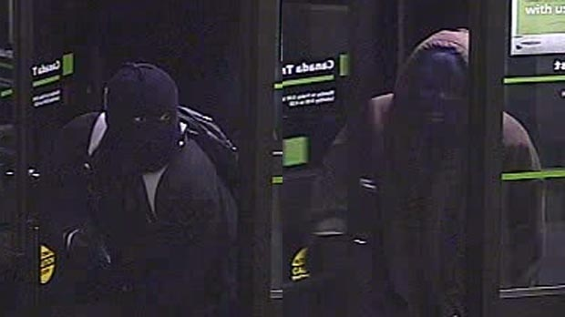 Surveillance images show two suspects wanted in connection with a bank robbery in Waterloo, Ont. on Thursday, Nov. 1, 2012. (Courtesy Waterloo Regional Police Service)