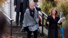 Quebec Premier Pauline Marois, centre, walks to a