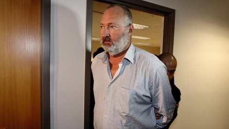 Actor Randy Quaid is escorted from an Immigration and Refugee Board hearing in Vancouver, B.C., on Friday October 22, 2010. THE CANADIAN PRESS/Darryl Dyck