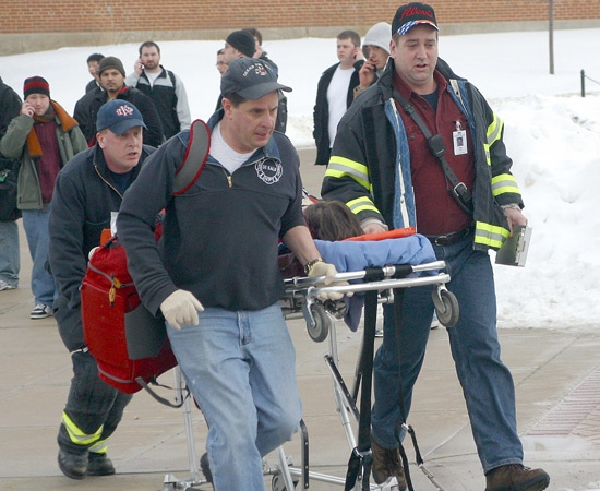 In this photo provided by the student-run Northern Star newspaper, rescue workers transport an unidentified victim from the scene of a shooting at a lecture hall at Northern Illinois University in DeKalb, Ill., Thursday, Feb. 14, 2008.