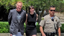 Actor Randy Quaid and his wife Evi Quaid are escorted from Santa Barbara County court on in this April 26, 2010 photo in Santa Barbara, Calif.