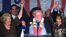Toronto Mayor-elect Rob Ford, centre, raises his arms with his wife Renata, right, and mother Diane, left, as he speaks to supporters in Toronto on Monday, Oct. 25, 2010. (Nathan Denette / THE CANADIAN PRESS)