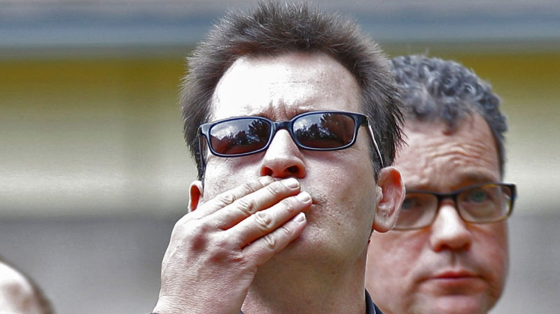 Charlie Sheen blows a kiss as he arrives at the Pitkin County Courthouse in Aspen, Colo., on Monday, Aug. 2, 2010, for a hearing in his domestic abuse case. (AP Photo/Ed Andrieski)