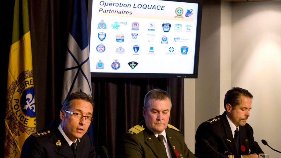 Gaétan Courchesne, left, with the RCMP, Jean Audette, centre, from the Sûreté du Québec and Pierre Brochet, right, with the Montreal Police speak to reporters at a news conference in Montreal, Thursday, Nov. 1, 2012. (Ryan Remiorz / THE CANADIAN PRESS)