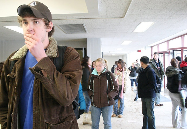 Students wait in DuSable Hall at Northern Illinois University on Thursday, Feb. 14, 2008. (Stacey Huffstutler / Northern Star)