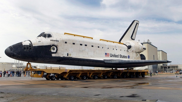 Space shuttle Atlantis is moved from the Orbiter Processing Facility to the Vehicle Assembly Building at Kennedy Space Center in Cape Canaveral, Fla. on Wednesday, Oct. 17, 2012 (AP / John Raoux)