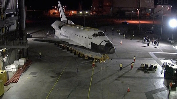 Space shuttle Atlantis is seen as it prepares to make its final departure from the Vehicle Assembly Building at NASA's Kennedy Space Center in Florida, Friday, Nov. 2, 2012.