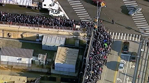 Hundreds of people line the streets to get gas in suburban New York's Westchester County, Friday, Nov. 2, 2012.