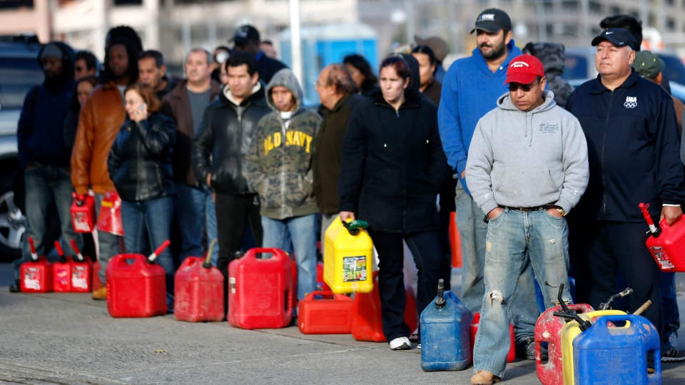 People line up at a gas station waiting to fill up, Friday, Nov. 2, 2012, in Newark, N.J. In parts of New York and New Jersey, drivers lined up early Friday for hours at gas stations that were struggling to stay supplied.  (AP / Julio Cortez)