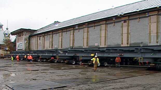 Lansdowne Park's historic Horticulture building has started a 120 metre roll across its parking lot Friday, Nov. 2, 2012.