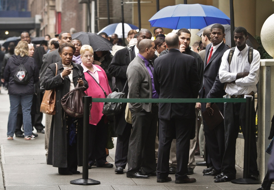 Job seekers wait in line to see employers at the National Career Fairs' job fair in New York, Wednesday, Oct. 24, 2012. (AP / Bebeto Matthews)