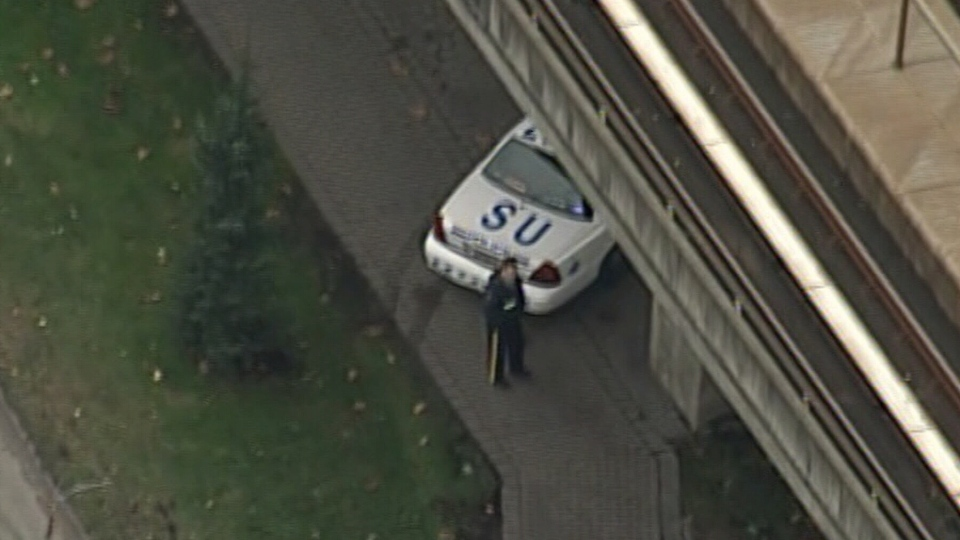 Police are shown at the scene where a suspicious device was discovered on the Vancouver SkyTrain tracks on Friday, Nov. 2, 2012.