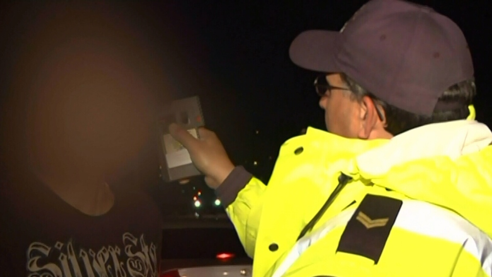 A police officer gives a drinking-and-driving suspect a breathalyzer test in Vancouver in this undated image.