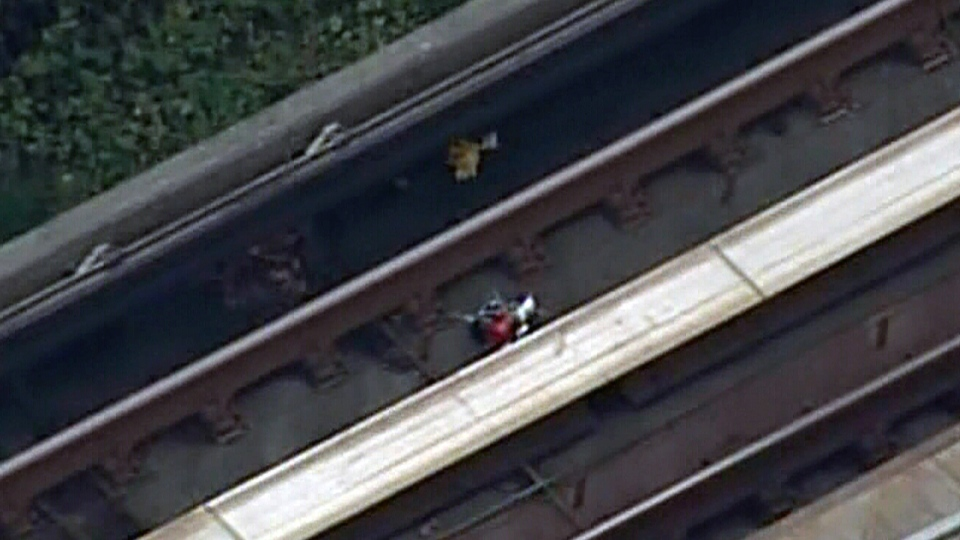 The explosive device discovered along the tracks of the SkyTrain commuter line in Surrey, B.C. is visible from the CTV News helicopter over the scene, Friday, Nov. 2, 2012.