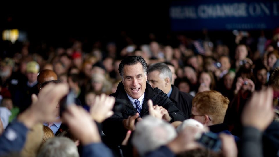 Republican presidential candidate, former Massachusetts Gov. Mitt Romney, greets supporters after speaking at a campaign event at Dubuque Regional Airport in Dubuque, Iowa, before flying to Colorado, Saturday, Nov. 3, 2012. (AP / David Goldman)