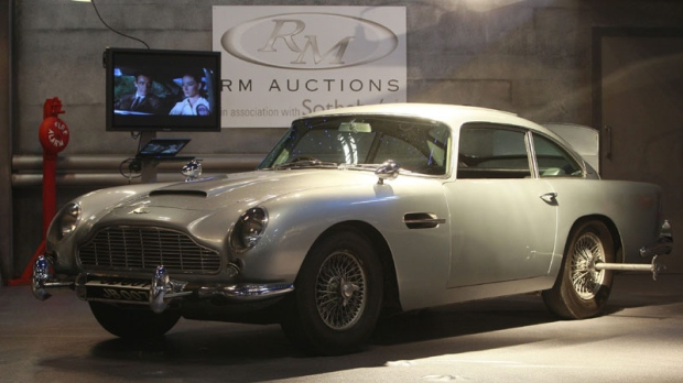 The 'James Bond' 1964 Aston Martin DB5, is viewed by the media, in London, Tuesday, Oct. 26, 2010. (AP Photo/Alastair Grant)