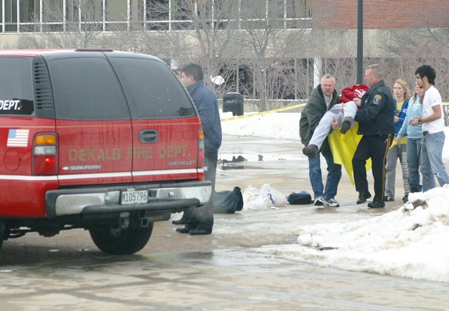 In this photo provided by the student-run Northern Star newspaper, rescue workers carry an unidentified victim from the scene of a shooting at a lecture hall at Northern Illinois University in DeKalb, Ill. on Thursday, Feb. 14, 2008.