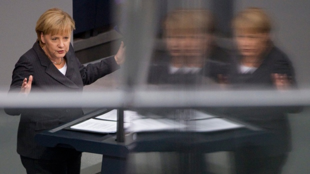German Chancellor Angela Merkel is reflected in a glass panel as she delivers a speech at the German Federal Parliament Bundestag in Berlin, Germany, Wednesday, Oct. 27, 2010. (AP / Gero Breloer)