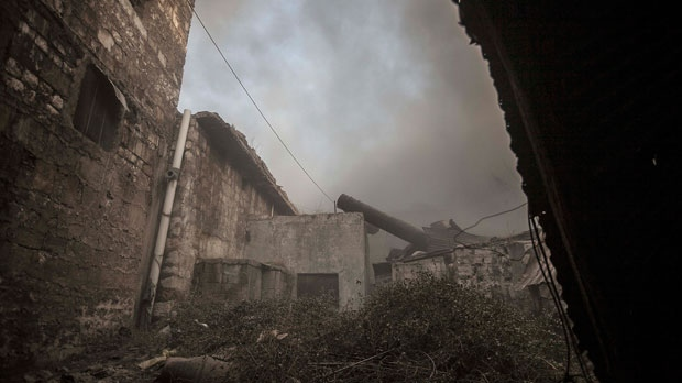 Smoke rises from an explosion as loyalists to President Bashar Assad launch a coordinated attack using mortar, tank and aerial artillery on rebel positions in the Jedida district of Aleppo, Syria, Saturday, Nov. 3, 2012. (AP / Narciso Contreras)