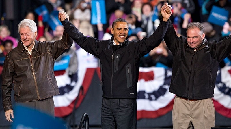 In the final hours of a four-state campaign day, U.S. President Barack Obama is joined by former President Bill Clinton, left, and Democratic candidate for the U.S. Senate from Virginia, former Gov. Tim Kaine, at a rally at Jiffy Lube Live arena, in Bristow, Va., Saturday, Nov. 3, 2012. (AP /J. Scott Applewhite)