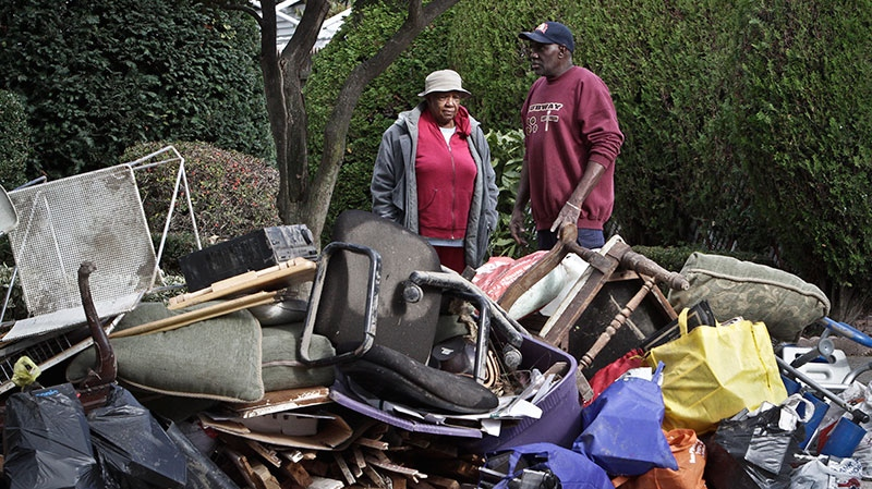 Ruby McLean, 89, and her son Kenneth Davis survey destroy items from their home, as they cleanup from flooding in the aftermath of superstorm Sandy in the Brooklyn borough of New York on Saturday, Nov. 3, 2012. (AP / Bebeto Matthews)