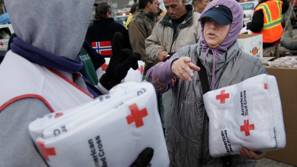 Galina Quacinella, right, gets some blankets for herself and her husband at a Red Cross aid station in Staten Island, New York, Sunday, Nov. 4, 2012. (AP / Seth Wenig)