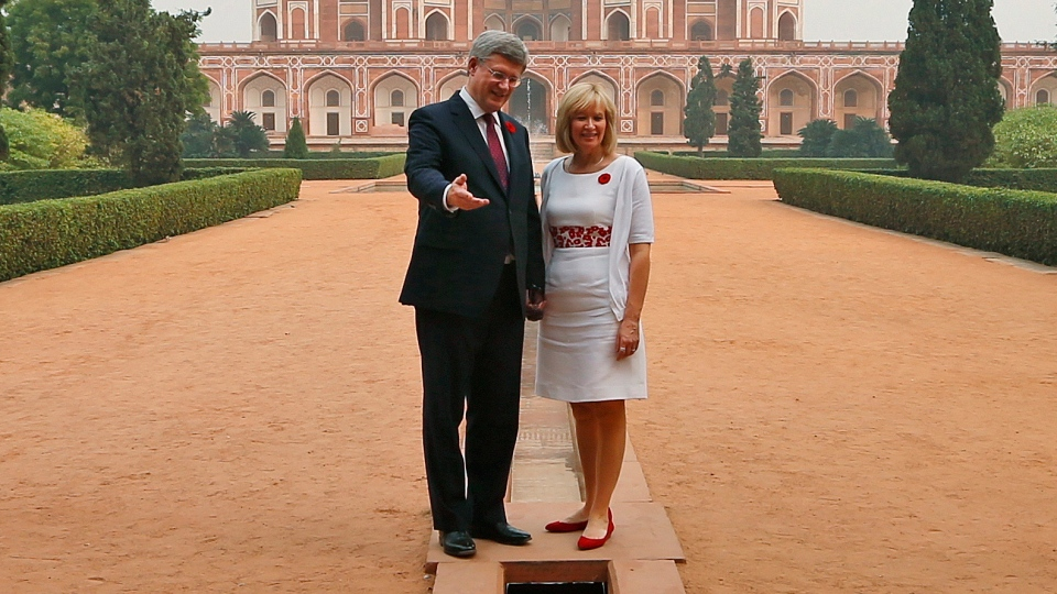 Prime Minister Stephen Harper, left, and his wife Laureen Harper pose for photographs after visiting Mughal emperor Humayun's tomb in New Delhi, India, Monday, Nov. 5, 2012. (AP / Saurabh Das)