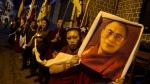 An exile Tibetan carries a portrait of the Tibetan spiritual leader the Dalai Lama during a candlelit vigil in Dharmsala, India, on Sunday, Nov. 4, 2012. (AP / Ashwini Bhatia)